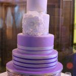 Purple tiered wedding cake