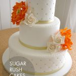 Orange peonies wedding cake